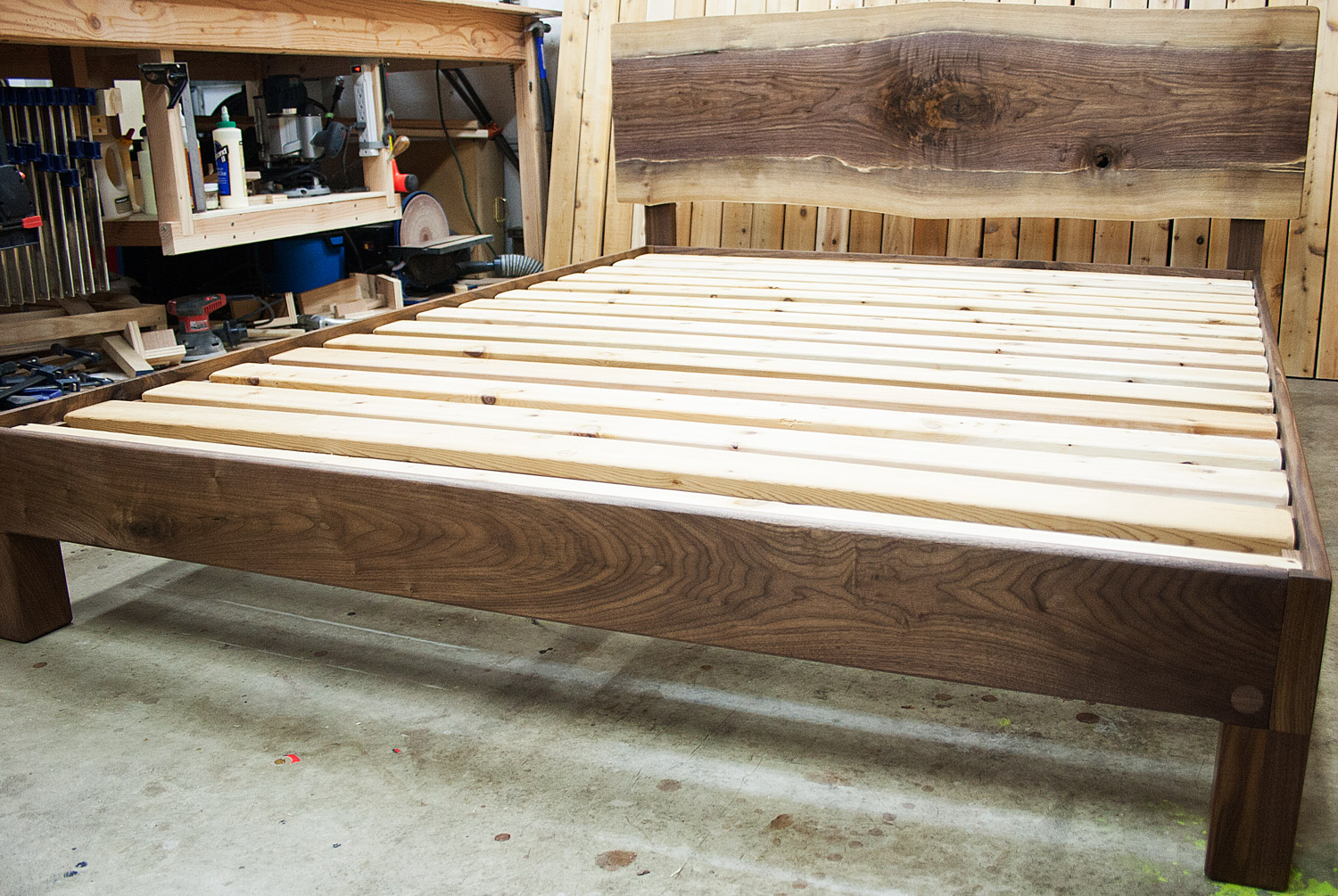 Live-edge walnut slab headboard and frame