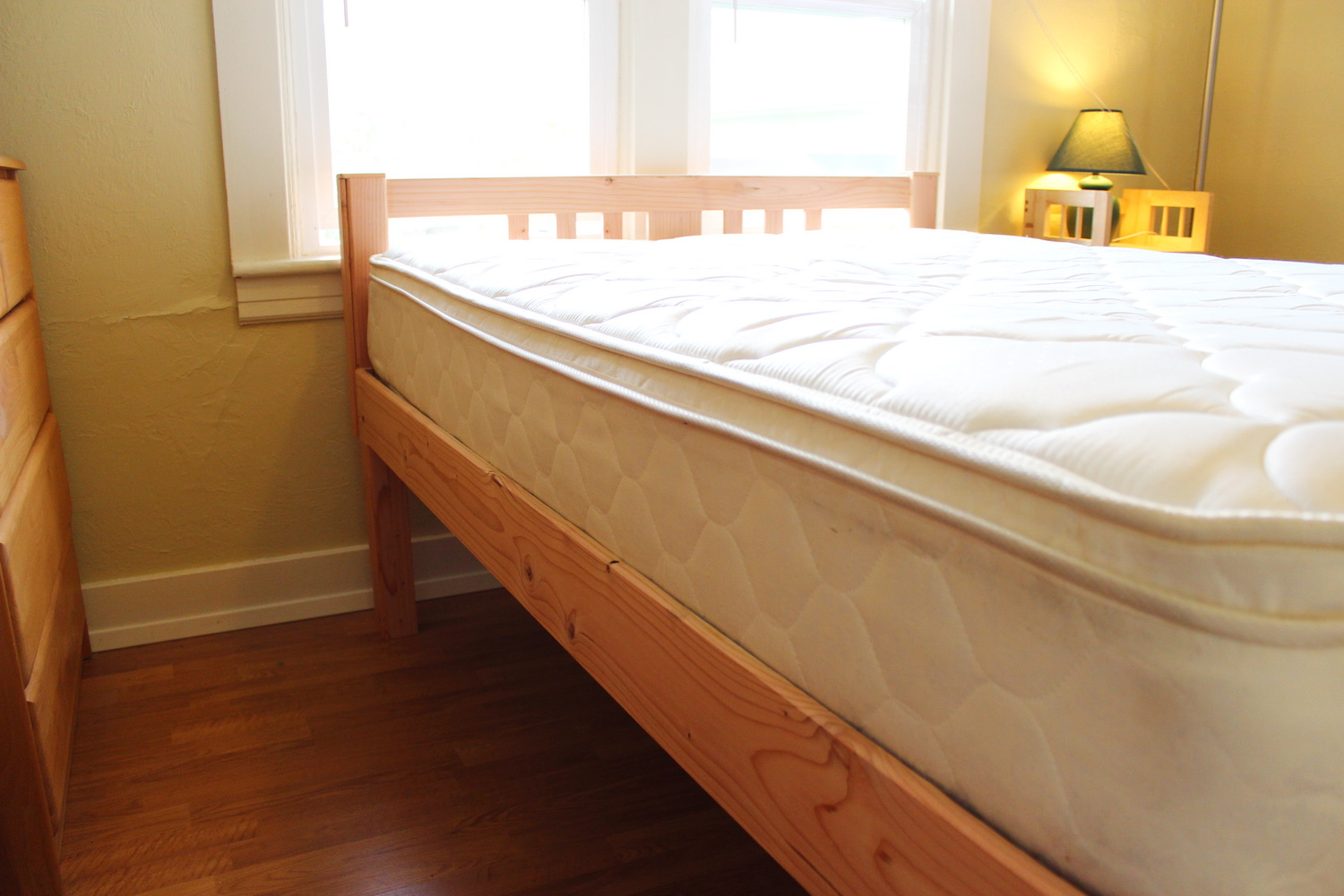 Fir queen with vertical-slat headboard