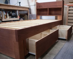 "9"" deep drawers and a storage headboard on this ash frame with dark shellac finish."